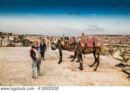 Goreme, Cappadocia- October 22, 2020 : Local people rent camels for riding and photography in Love Valley in Cappadocia, Goreme, Turkey.