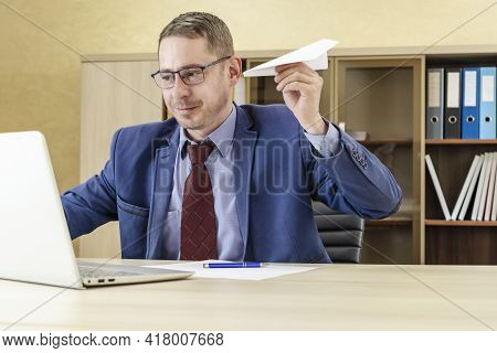 Distracted From Computer Work Happy 30s Young Bearded Caucasian Man In Glasses Throwing Paper Airpla
