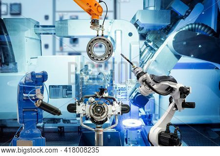 Industrial Automation Robotic Teamwork Working With Auto Parts On Smart Factory, On Machine Blue Ton