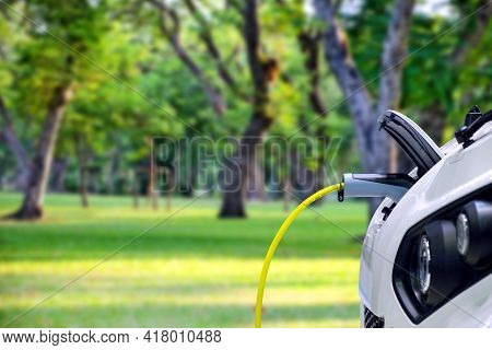 Close-up Smart Car (ev Car) Charging Battery Via Plug Connect Of Electric Charge Machine, Electric P