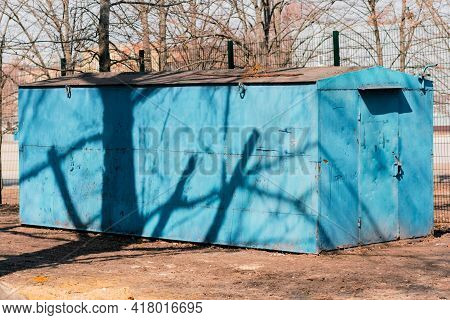 Blue Portable Storage Container With Door Installed In The Park. Locked. Outdoor. Industry. Metal. S