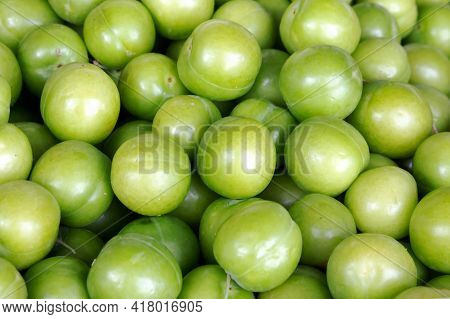 Green Plums On The Counter Of The Bazaar Close-up, Background