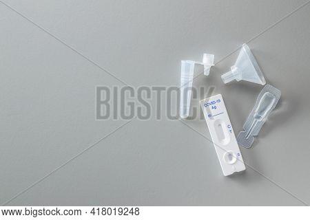 Covid-19 rapid antigen test. Rapid antibodies test kit on grey background. Top view.