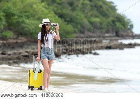 Happy Traveler And Tourism Young Women Travel Summer On The Beach. Asian Smiling People Holding Yel