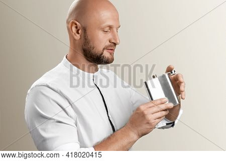 Bearded Man Drink Alcohol. Bearded Man Drink Alcohol From Metallic Flask. Alcohol Drink.