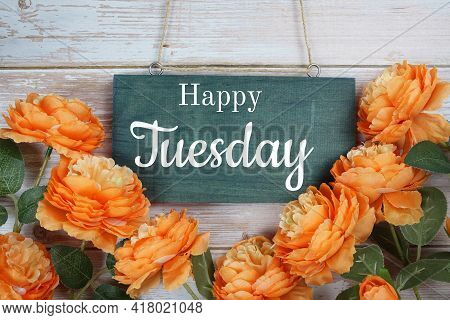 Happy Tuesday Typography Text With Flower Decoration On Wooden Background