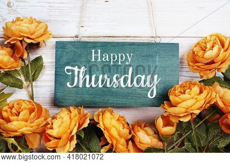Happy Thursday Typography Text With Flower Decoration On Wooden Background