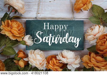 Happy Saturday Typography Text With Flower Decoration On Wooden Background