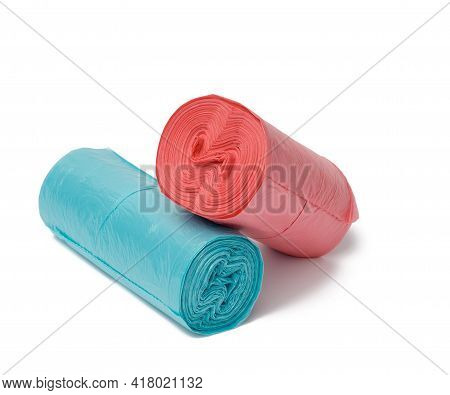 Blue And Red Polyethylene Trash Can Bag Rolls Isolated On White Background, Close Up