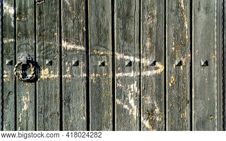 Surface Of An Old And Worn Wooden Door