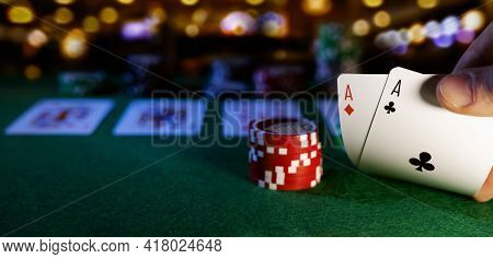 Play Poker In Casino. Pocket Aces And Chips. Copy Space