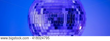 Shining Disco Ball party music equipment on blue wall background