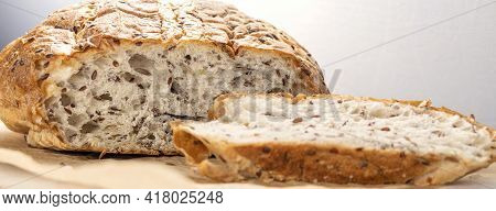 Banner With Fresh, Tasty, Round Wheat Bread With Flax Seeds On A White Textured Table With Space For