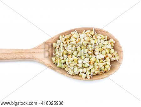 Sprouted Buckwheat Seeds In Wooden Spoon Isolated. Healthy Vegan Food. Vegetarian Food. Nature Vitam