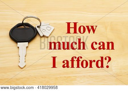 How Much Can I Afford Message With A Model House On A Key Chain On Wood Desk