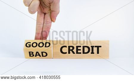 Good Or Bad Credit Symbol. Businessman Turns Cubes And Changed Words 'bad Credit' To 'good Credit'.