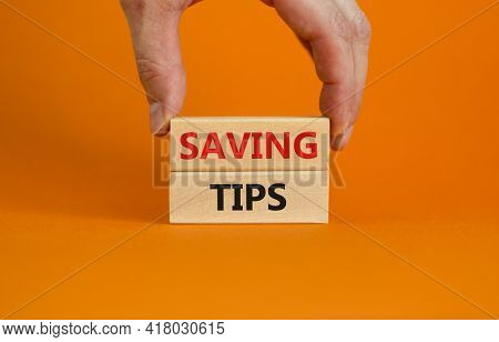 Saving Tips Symbol. Wooden Blocks With Words 'saving Tips' On Beautiful Orange Background. Businessm