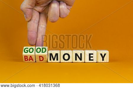 Good Or Bad Money Symbol. Businessman Turns Wooden Cubes And Changes Words 'bad Money' To 'good Mone