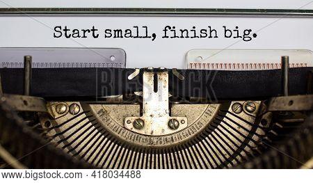 Start Small Finish Big Symbol. Concept Words 'start Small Finish Big' Typed On Retro Typewriter. Bus