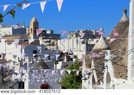 Alberobello Townscape With Traditional Houses - Trulli. Apulia Region Of Italy. Italian Landmark. Un