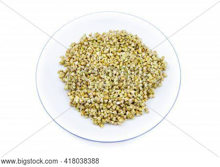 Sprouted Buckwheat Seeds On A White Plate Isolated. Healthy Vegan Food. Vegetarian Food. Nature Vita