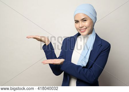 Close Up Of Young Beautiful Muslim Businesswoman With Hijab Isolated On White Background Studio