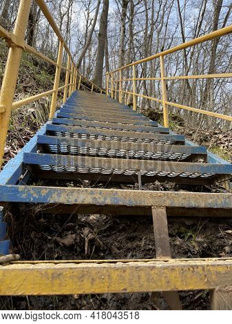 Close Up Of Metal Staircase In Woodland. Metal Stairway To Overcome Obstacles In Mountainous Terrain