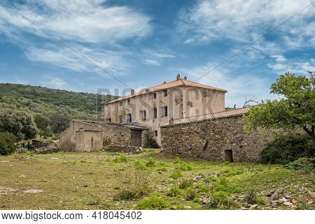 A Deserted Farm Building Surrounded By Lush Green Maquis At Ifana In Corsica