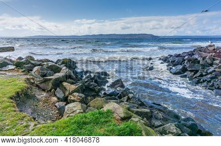 A View Of The Shoreline At Saltwater State Park In Des Moiness Washington On A Windy Day.