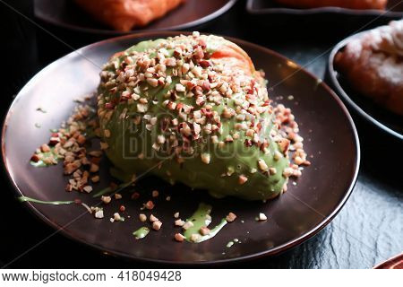 Croissant, French Croissant Or  Green Tea  Covered Croissant Or Croissant With Almond Topping