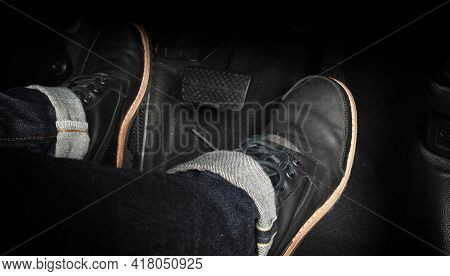 Close Up The Foot Pressing Foot Pedal Of A Car To Drive. Accelerator And Brake