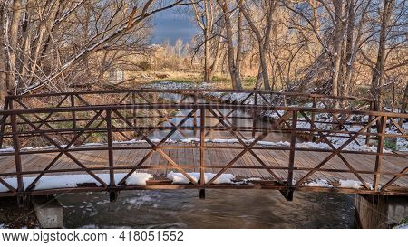 bike trail and footbridge over irrigation ditch in Fort Collins, northern Colorado, recreation and commuting concept in early spring scenery