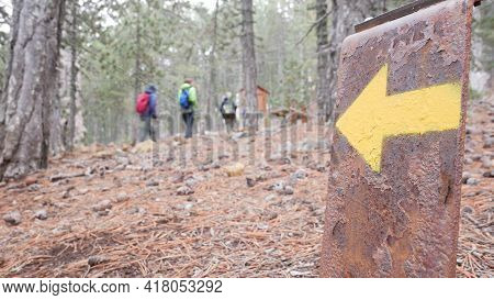 The Arrow Indicates The Direction Of The Hiking Trail And The Direction Of Travel. Drawn On A Metal