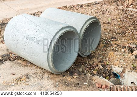 Concrete Drainage Pipe On A Construction Site.  Concrete Drainage Pipes Stacked For Construction. Co
