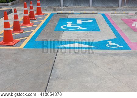 Parking For Disabled Or Wheelchair. A Sign Indicates Reserved Parking For Disabled People In A Car P