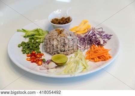 Rice Seasoned with Shrimp Paste Recipe or thai name Khaao Khlook Gabpi. A simple and basic Thai food