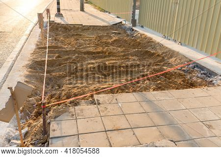 Installing Paving Bricks In Pedestrian Zone. Laying Paving Slabs At Construction Site On Walkway, St