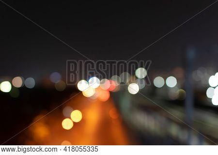 Abstract Bokeh Nightlight And Blur Car Light Bokeh On Street Background.
