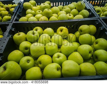 Ripe Green Apples Are Sold Among The Fruits In The Supermarket.