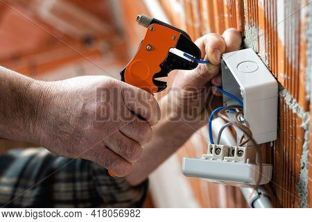 Electrician At Work On A Residential Electrical System. Electricity.