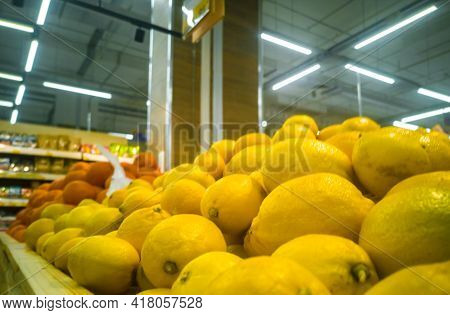 Selling Lemons In A Small Grocery Supermarket Close-up.