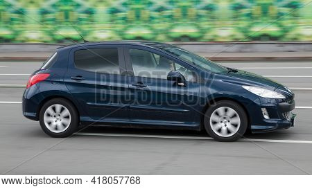 Moscow , Russia - April 2021: Hatchback Peugeot 308 Moves At High Speed In The City Street. Peugeot