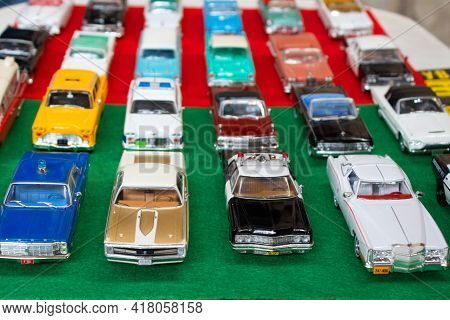 Lviv, Ukraine - March 7, 2021 - Group Of Retro Model Toy Cars - Yellow New York Taxi, Vintage Police