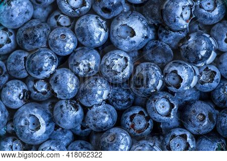 Blueberries Floating In Water With Bubbles. Fresh Blueberries Background With Copy Space For Your Te