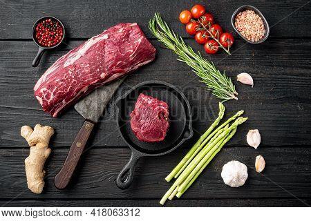 Raw Beef Meat Steak Tenderloin Fillet Mignon Set, In Cast Iron Frying Pan, On Black Wooden Table Bac