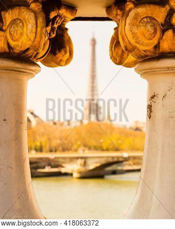 Alexander Iii Bridge On The Background Unfocused Eiffel Tower. Paris, France.