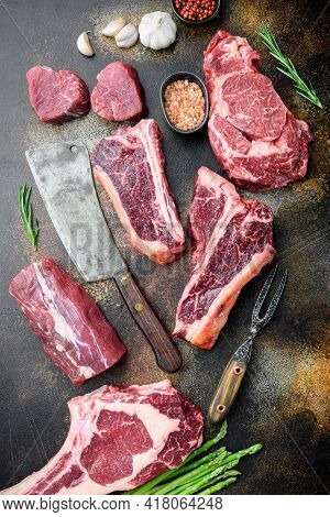 Variety Of Raw Beef Meat Steaks For Grilling With Seasoning And Utensils Set, Tomahawk, T Bone, Club