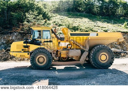 Yellow Quarry Dump Truck Standing On The Road