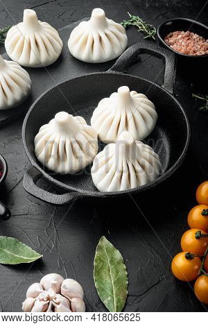 Uzbek Manti. Manti Or Manty Dumplings, Popular Uzbek-asian Dish Set, In Frying Cast Iron Pan, On Bla