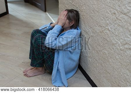 Stress Senior Woman Sitting On The Floor With His Face In His Hands. Depression Concept, Panic Attac